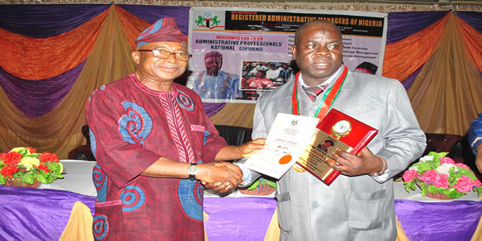 Professor Bello Sabo f.Inst.Am of ABU Receiving IRAMN Fellowship Plague